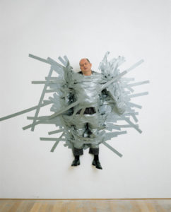 A Perfect Day, 1999 Gallerist Massimo De Carlo of Milan attached to the wall by duct tape by Maurizio Cattelan