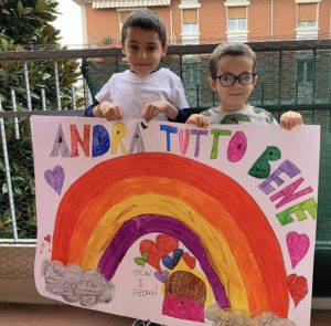"""The children of Italy are making posters to hang on their balconies and in their gardens: """"Everything will be okay."""""""