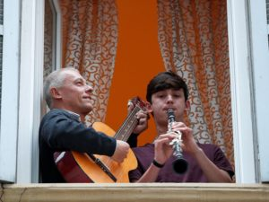 Italians in self-quarantine this week hold impromptu concerts from their balconies and jam with their neighbours.