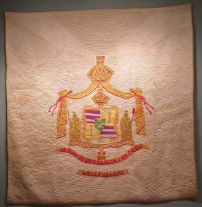 Ua Mau Ke Ea O Ka Aina I ka Pono-Halepualani (The life of the land is perpetuated in righteousness) Hawaiian quilt, silk satin, wool batting, cotton Honolulu Museum of Art
