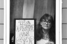 Professor and activist Dr. Kristin Lawler poses for 'Words At The Window: Self Isolation And The Coronavirus', a portrait series by Shutterstock Staff Photographer, Stephen Lovekin, shot around the Ditmas Park neighborhood of Brooklyn, New York.