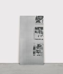 "Rubberneck Communion, 1991 Silkscreen on aluminium 75 3/8 by 36 1/4 inches by Cady Noland This Statement from the Artist accompanied this work when being sold at auction in 2016: ""In an atmosphere of rapidly trading artwork, it is not possible for Cady Noland to agree or dispute the various claims behind works attributed to her. Her silence about published assertions regarding the provenance of any work or the publication of a photograph of a work does not signify agreement about claims that are being made. Ms. Noland has not been asked for nor has she given the rights to any photographs of her works or verified their accuracy or authenticity."""