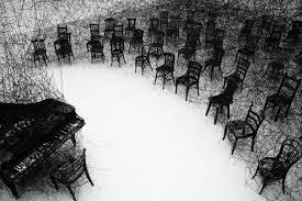 In Silence, 2008 Burnt piano, burnt chair, black wool by Shiota Chiharu (b.1972)